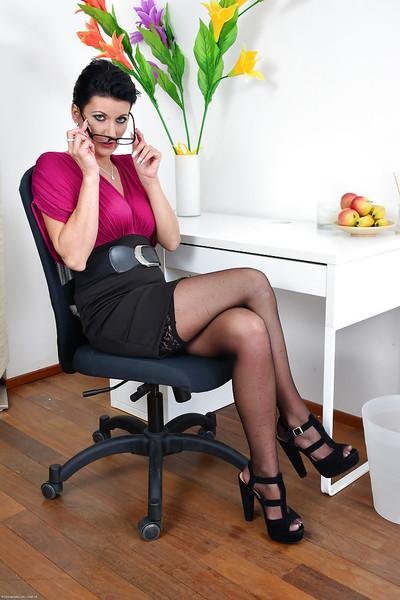 Milf babe Celine Noiret dose some posing in her office while in high heels