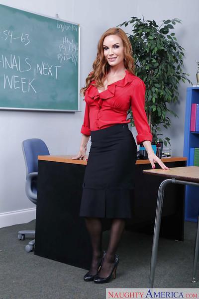 Latina schoolteacher Diamond Foxxx posing in skirt and black stockings