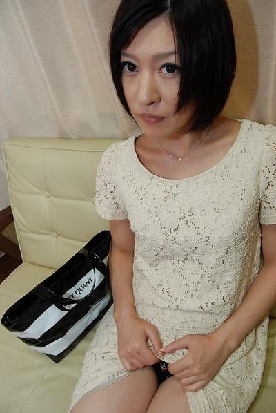 Stunning short-haired model Mari Suzui is masturbating her holes