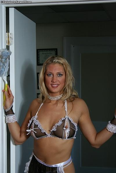 Lusty MILF maid with big tits spreading her pussy and teasing her clit