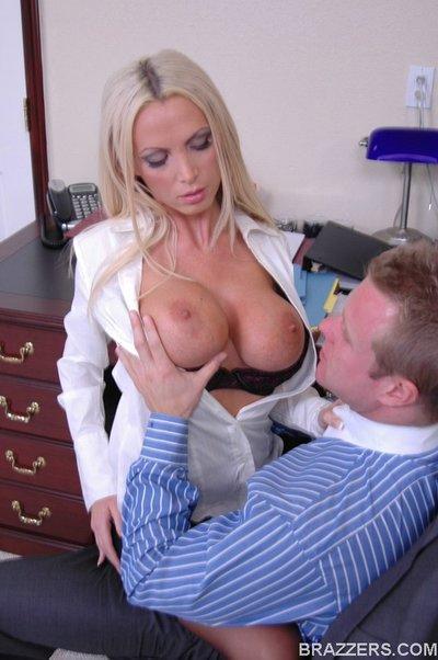 MILF with huge boobs Nikki Benz satisfies a big cock in the office