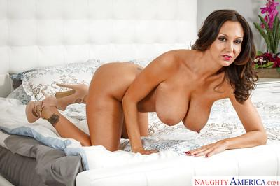 Milf brunette Ava Addams demonstrates her ideal naked body on the bed