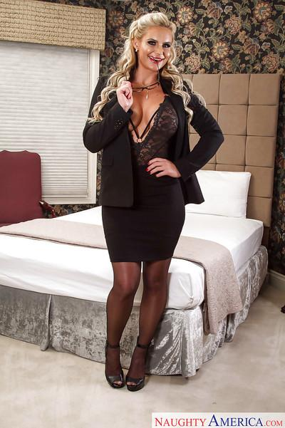 Tall blond in glasses Phoenix Marie flashing thigh above stocking clad legs
