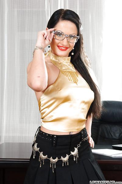 Lustful MILF in glasses stripping and spreading her legs in the office