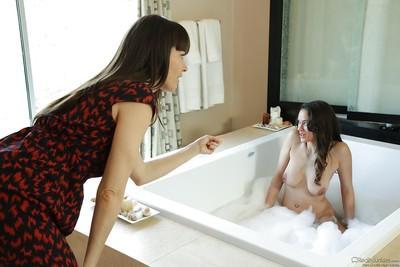 Dana DeArmond and Leilani Gold having lesbian sex in a hot bath