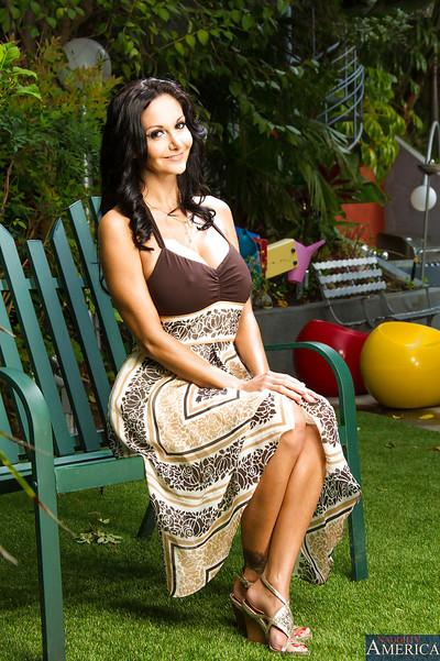 Brunette milf Ava Addams is posing outdoor in her sexy long dress