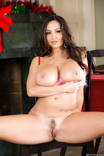 Chesty brunette MILF Ava Addams exposing her massive juggs at Christmas