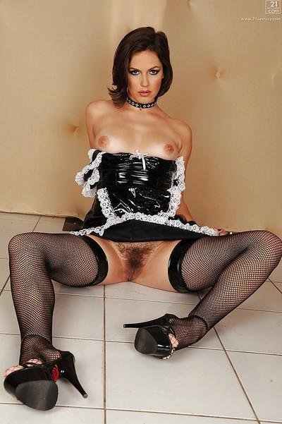 Sultry maid Bobbi Starr showing off hairy pussy underneath maid uniform