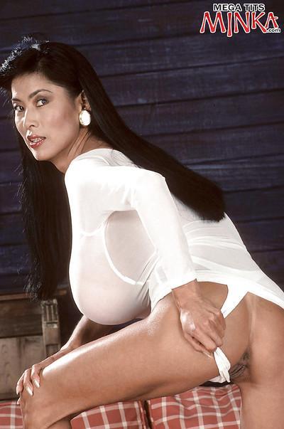 Asian MILF babe Minka fondling massive juggs in panties and high heels