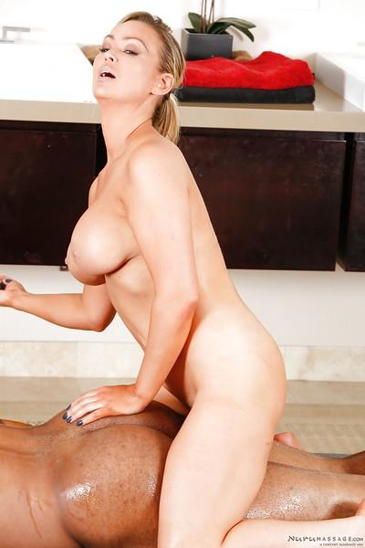 Blonde mom Abbey Brooks delivering a sexy nuru massage to black man