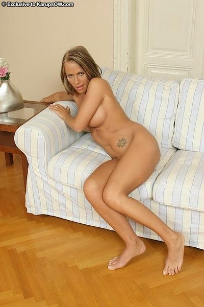 Voluptuous blonde MILF pleasing her shaved cunt with a big vibrator
