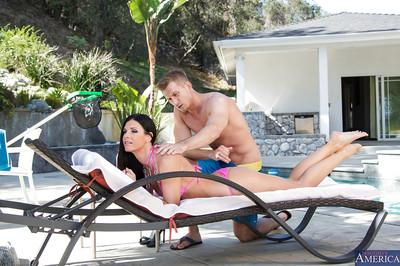 Brunette milf India Summer is posing outdoor at the pool