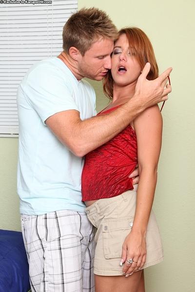 Bosomy redhead MILF enjoys passionate twatting and gets facialized