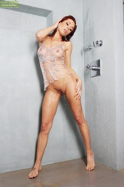 Enticing milf Kirsten Price gets in the shower and rinses her pussy