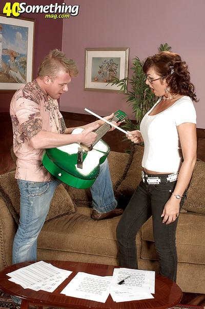 Mature music tutor with huge tits Desi Foxx gets fucked hard by a punk rocker