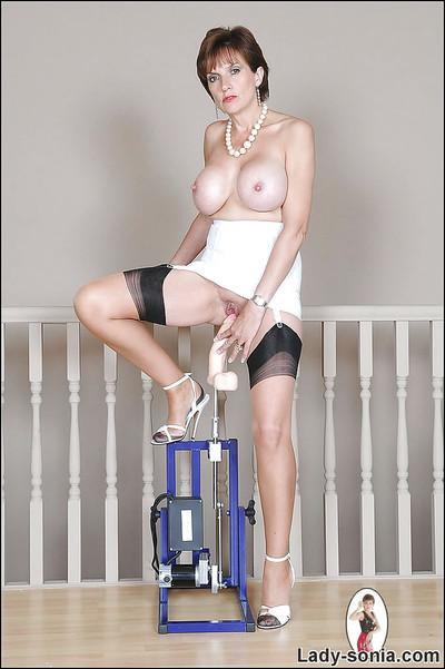 Lusty mature babe in nylon stockings riding a fucking machine