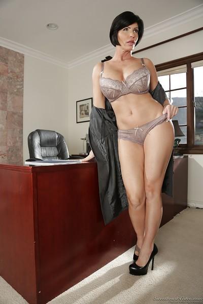 Brunette boss woman Shay Fox removes dress for lingerie photo shoot
