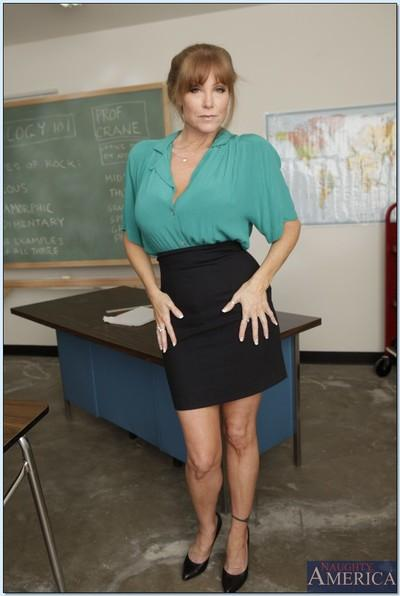Mature teacher Darla Crane shows big tits and hot ass stripping skirt
