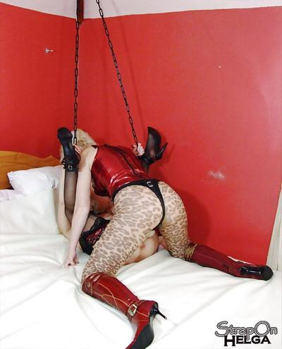 Helga fucking her friend by using various toys and bondage devices