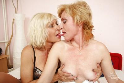 Mature lesbians in stockings and high heels tongue kiss before licking twat