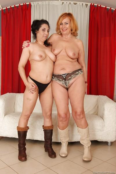 Lesbians Lady and Alexia F are playing with their hairy twats