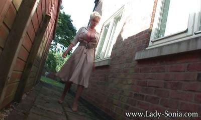 Big tits mature slut Lady Sonia is pissing somewhere behind a house
