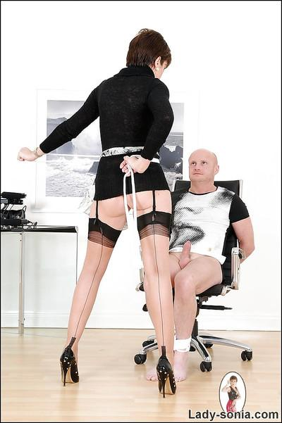Mature femdom on high heels teasing her tied up male pet