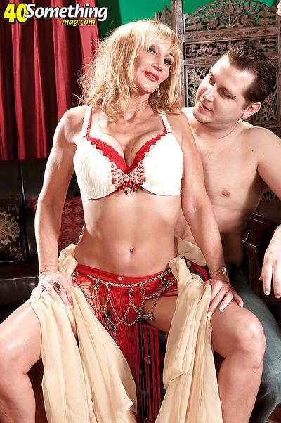 Opal Reins is a hot MILF lady who earns extra cash as an exotic dancer and sometimes she lets her customers enjoy in her big tits.
