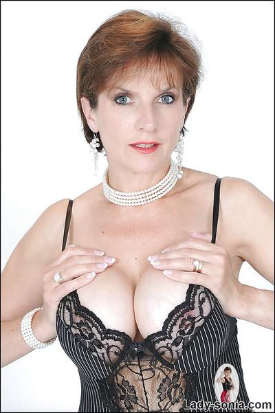 Sexy mature fetish gal in stockings and lingerie uncovering her big jugs
