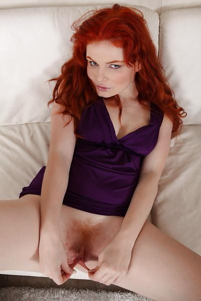 Older redhead babe Babeurre pleases her mature pussy with a kinky toy