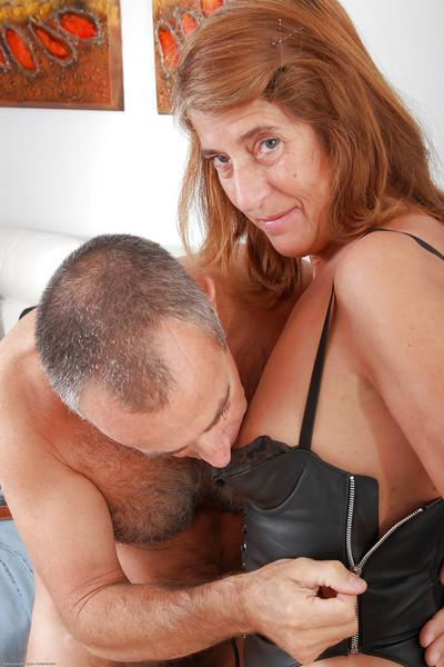Hairy older woman Meg looking fine in leather bodice and stockings