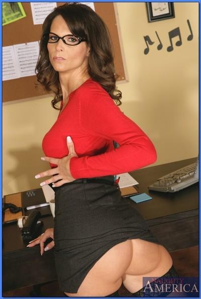 Mature teacher in glasses Syren De Mer stripping to black stockings