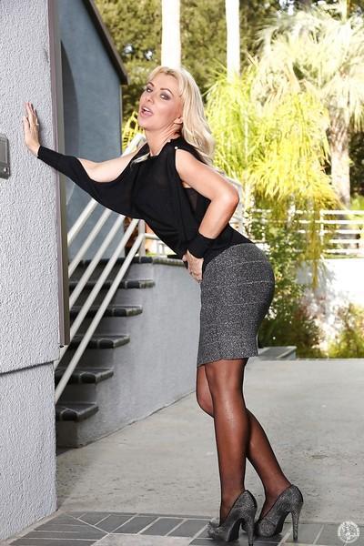 Housewife blonde Sasha Sean poses in her amazing black lingerie