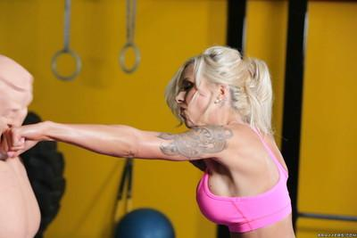 Tattooed blonde milf Nina Elle practices sports with oiled big tits