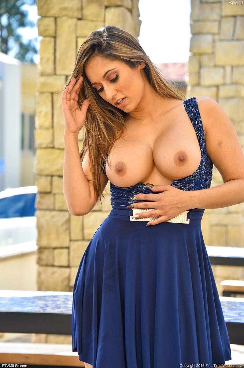 Hot busty cougar in a sexy dress