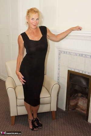 Mature blonde Dirty Doctor fingers her slit after removing a black dress
