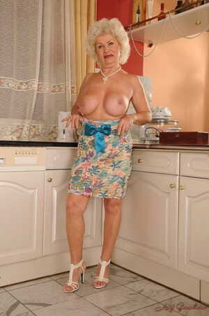 Horny granny with big tits Effie gets fucked by the handyman in the kitchen
