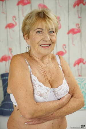 Freaky granny with big tits Malya gets fucked and jizzed by a handsome gigolo