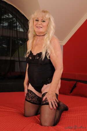 Blonde mature granny Mylen sheds black lingerie for young stud fuck & facial