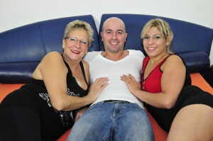 German babes suck him off before he fucks them hard in this threesome