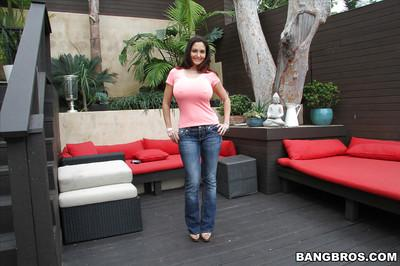 Hot MILF Ava Addams posing topless outdoors in jeans and high heels