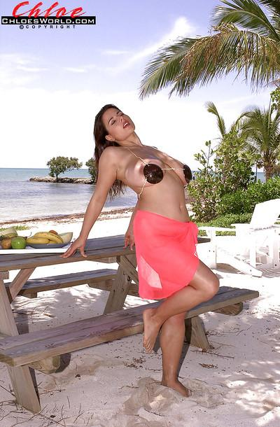 Curvy MILF Chloe Vevrier playing with her massive boobs outdoor