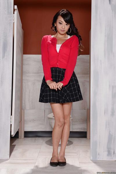 Asian MILF Miko Dai lifts skirt to reveal pretty white panties