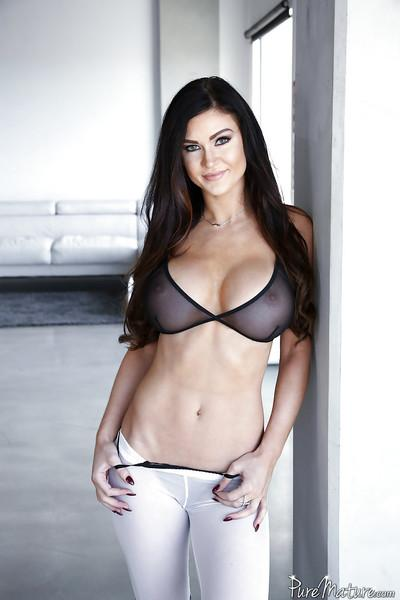 Sexy brunette babe Kendall Karson poses in yoga pants while baring big tits