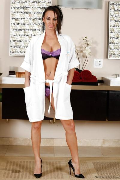 MILF Alektra Blue posing solo in matched bra and panty set