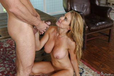 Buxom blonde Corinna Blake giving bj and taking cumshot on huge honkers