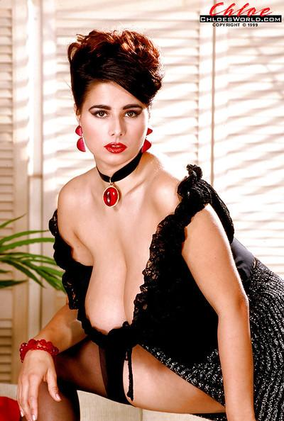 Stocking and garter attired MILF plumper Chloe Vevrier baring massive boobs