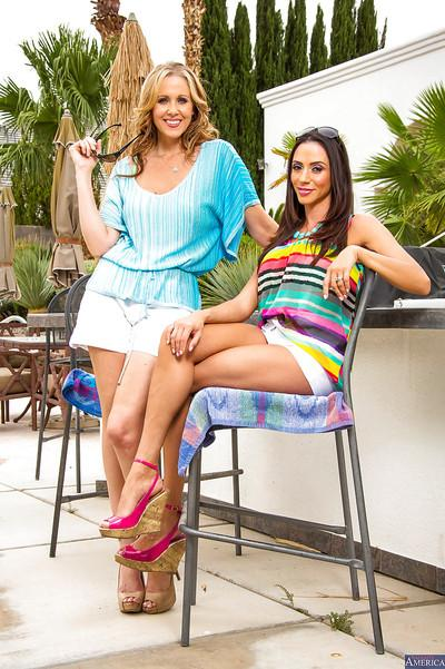 Ariella Ferrera and Julia Ann are posing naked and licking pussies