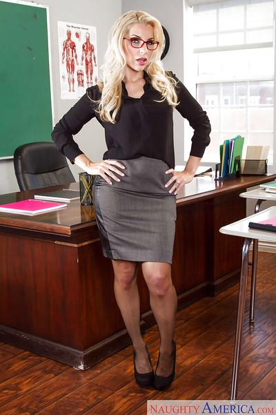 Blonde teacher Ashley Fires posing clothed in nylons, skirt and glasses