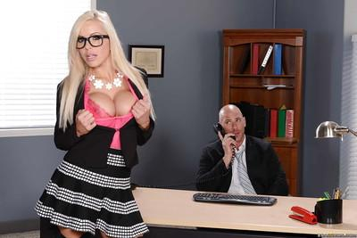 Nina Elle is enjoying a big cock in her stockings while in office